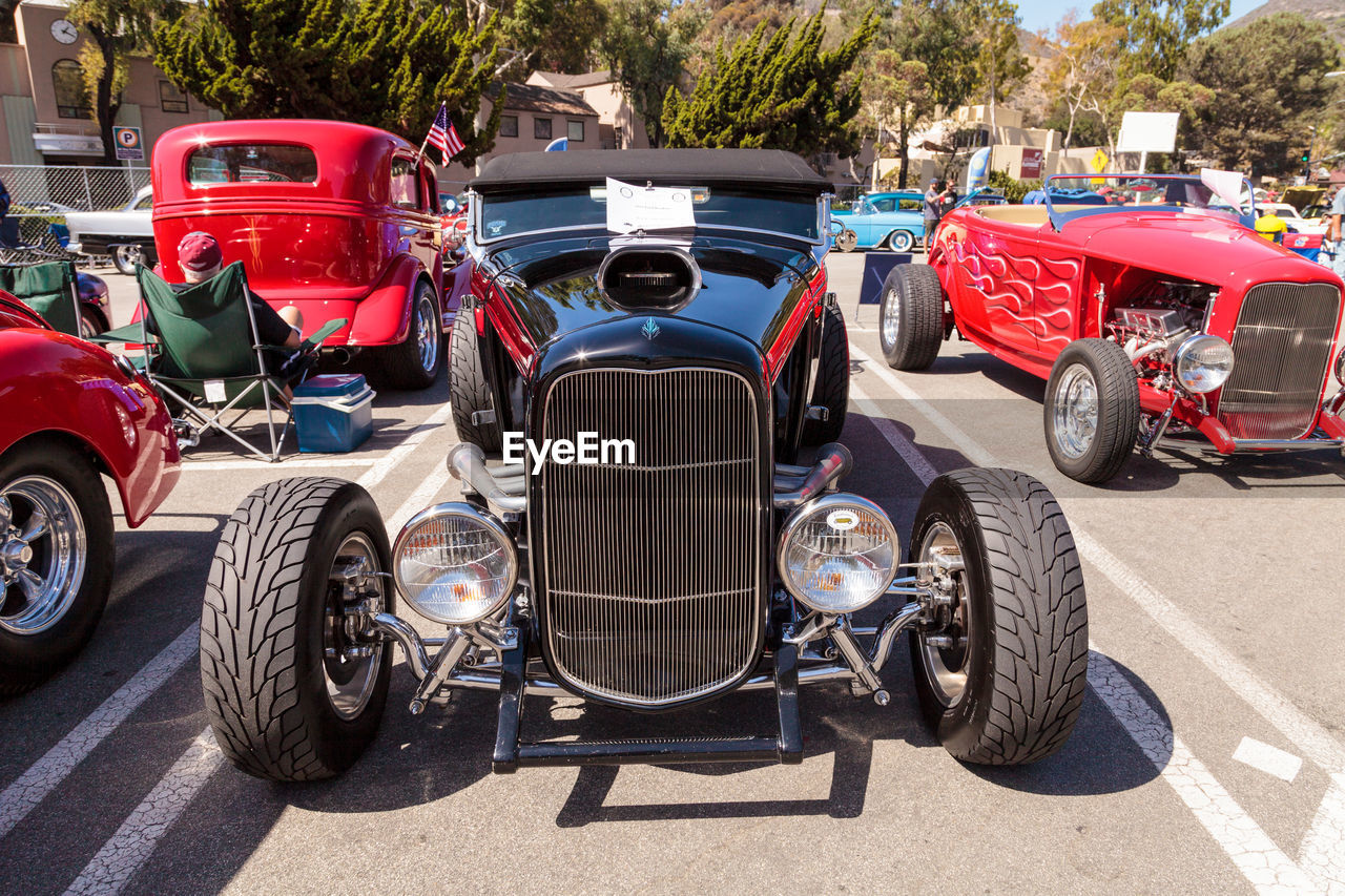mode of transport, car, transportation, red, land vehicle, outdoors, sports race, shadow, tire, day, competition, no people