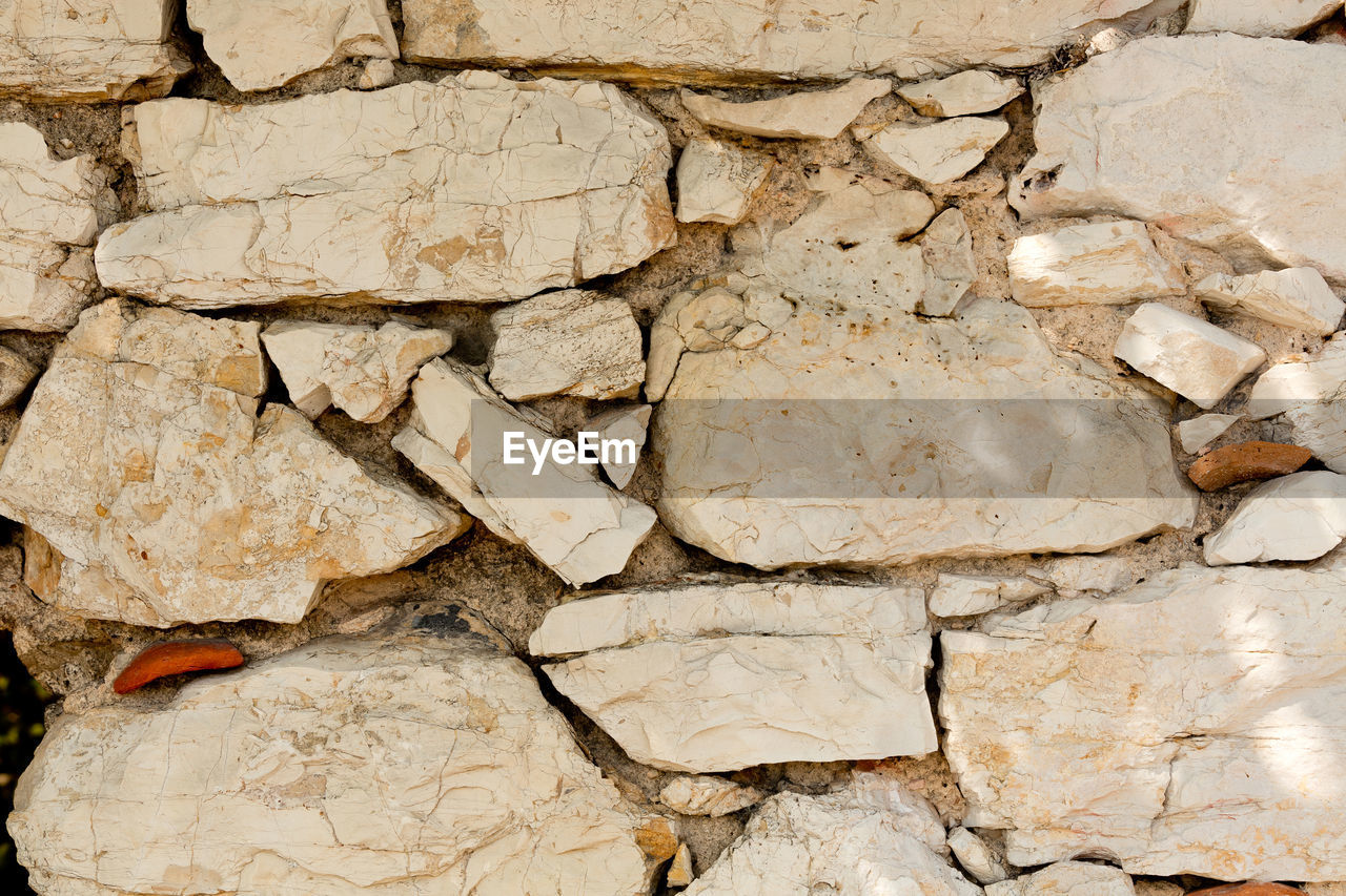 backgrounds, textured, full frame, stone material, cracked, damaged, rock - object, no people, close-up, built structure, nature, outdoors, day