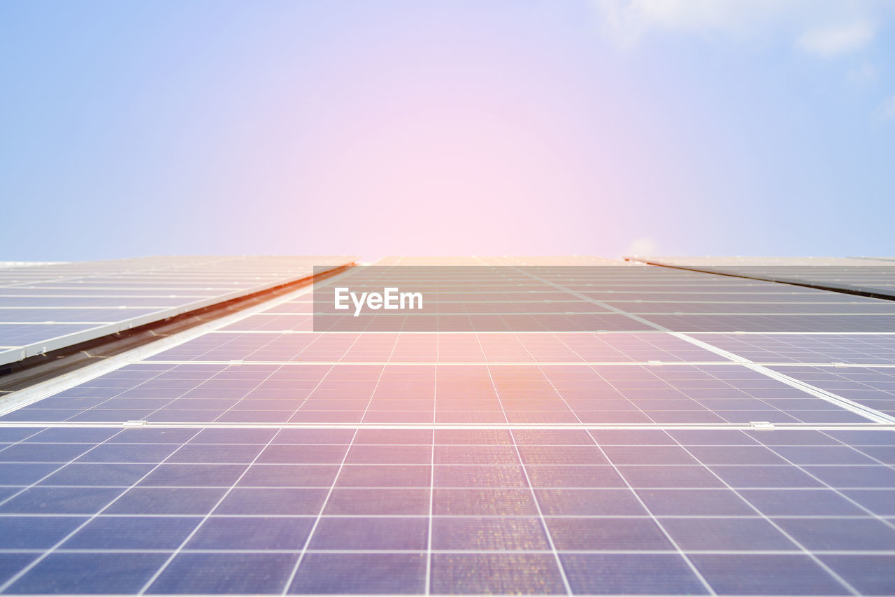 sky, sunlight, solar panel, solar energy, blue, nature, clear sky, copy space, environmental conservation, day, no people, low angle view, alternative energy, outdoors, renewable energy, fuel and power generation, pattern, environment, sun, solar power station, sustainable resources, power supply