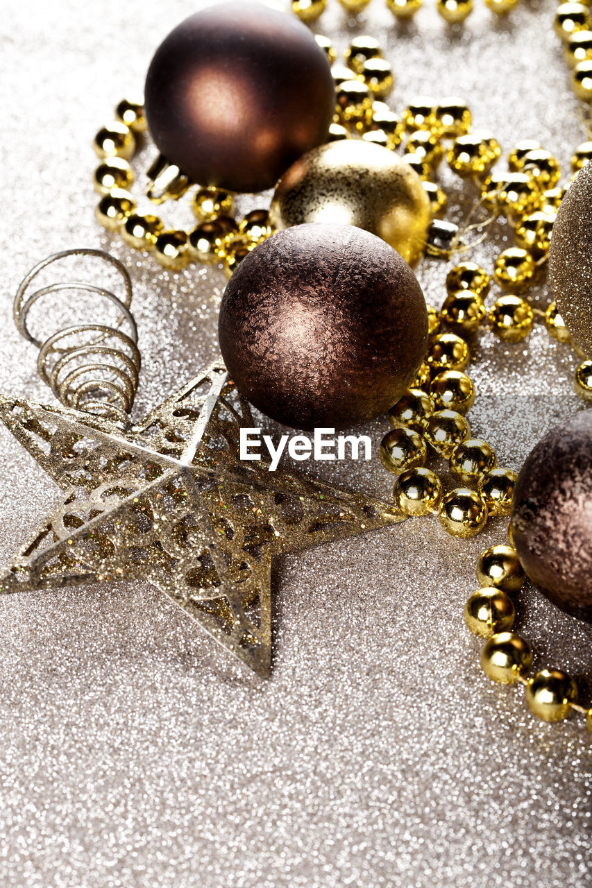 jewelry, gold colored, wealth, no people, close-up, necklace, still life, indoors, gold, shiny, high angle view, christmas decoration, luxury, christmas, pearl jewelry, celebration, holiday, religion, christmas ornament, bead, expense