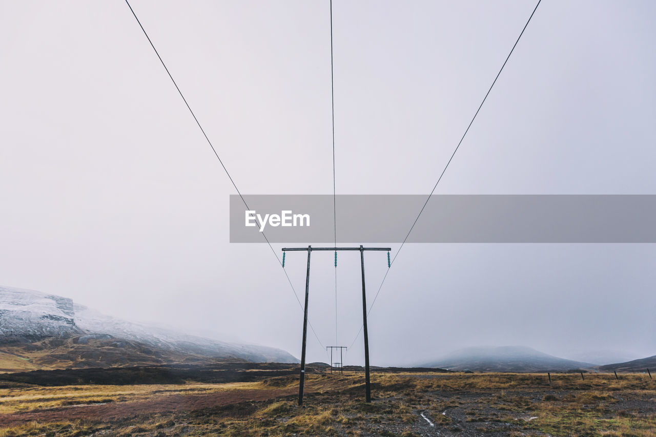 sky, cable, scenics - nature, mountain, electricity, landscape, tranquility, tranquil scene, no people, environment, nature, beauty in nature, land, day, non-urban scene, clear sky, technology, fuel and power generation, mountain range, connection, outdoors, power supply
