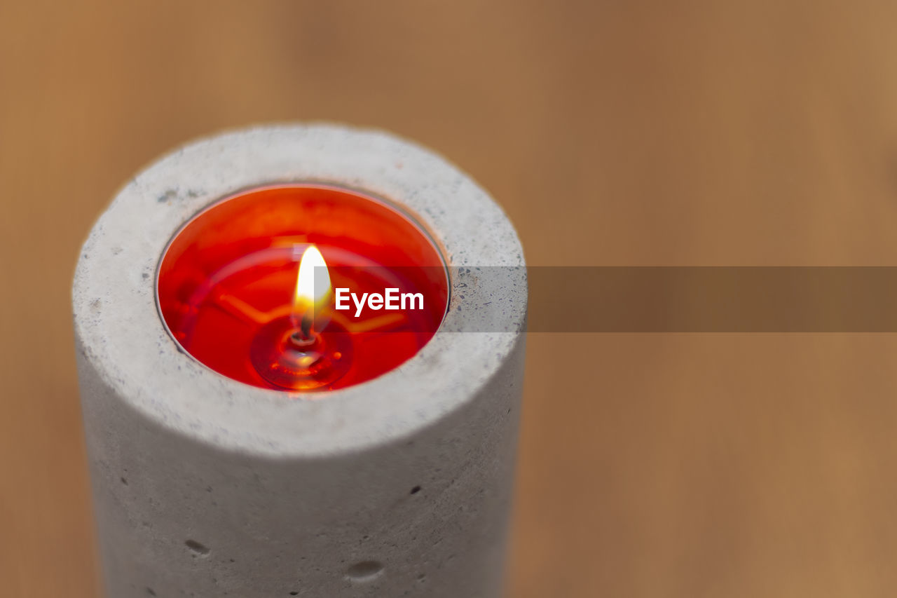 High angle view of illuminated candle