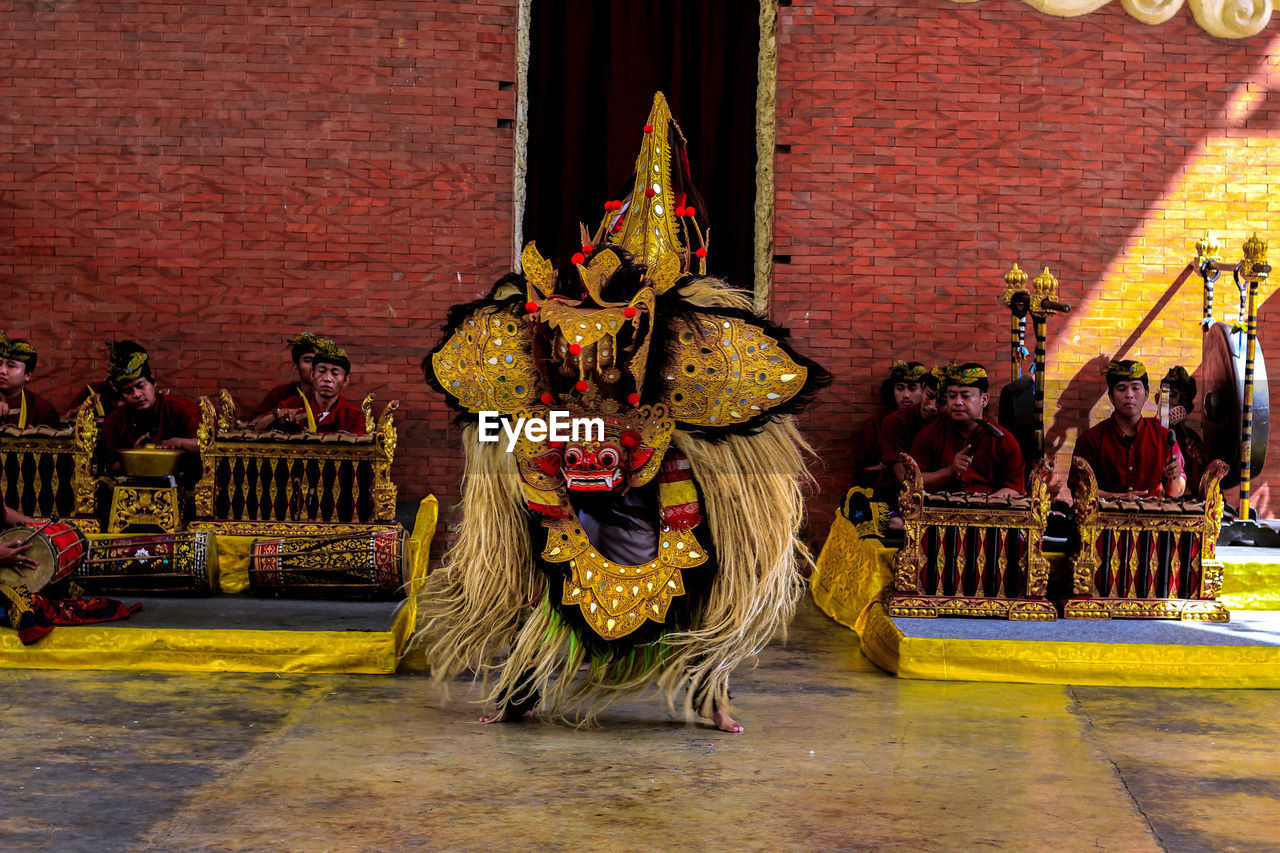 architecture, built structure, representation, celebration, art and craft, animal representation, real people, traditional clothing, group of people, full length, clothing, incidental people, building exterior, dancing, creativity, sculpture, festival