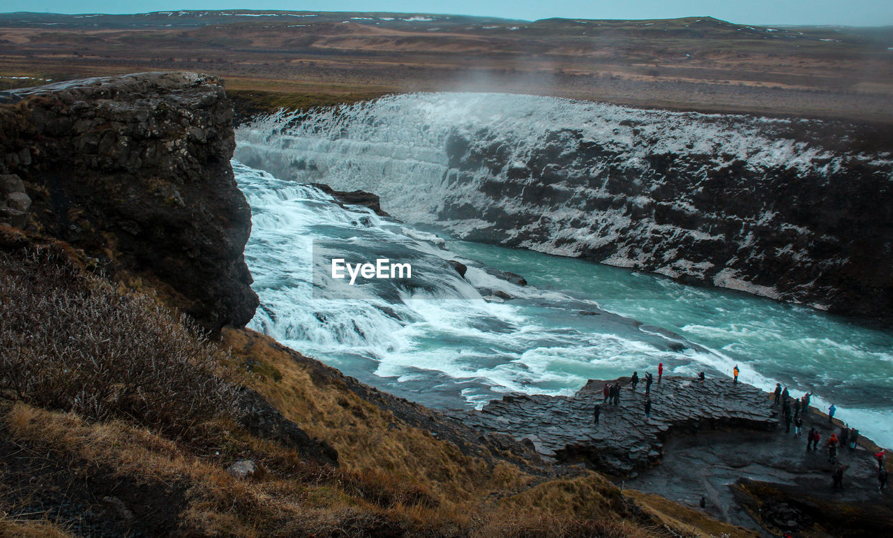 water, scenics - nature, beauty in nature, rock, motion, sea, nature, day, solid, no people, land, rock - object, aquatic sport, environment, sport, rock formation, outdoors, high angle view, power in nature, flowing water, flowing