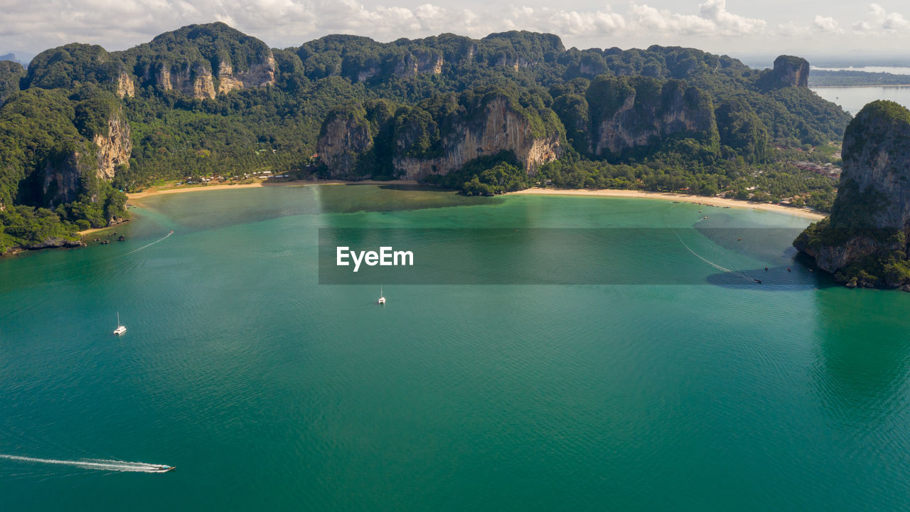 Amazing thailand high season beautiful seascape aerial view ao nang beach island and long tail boat