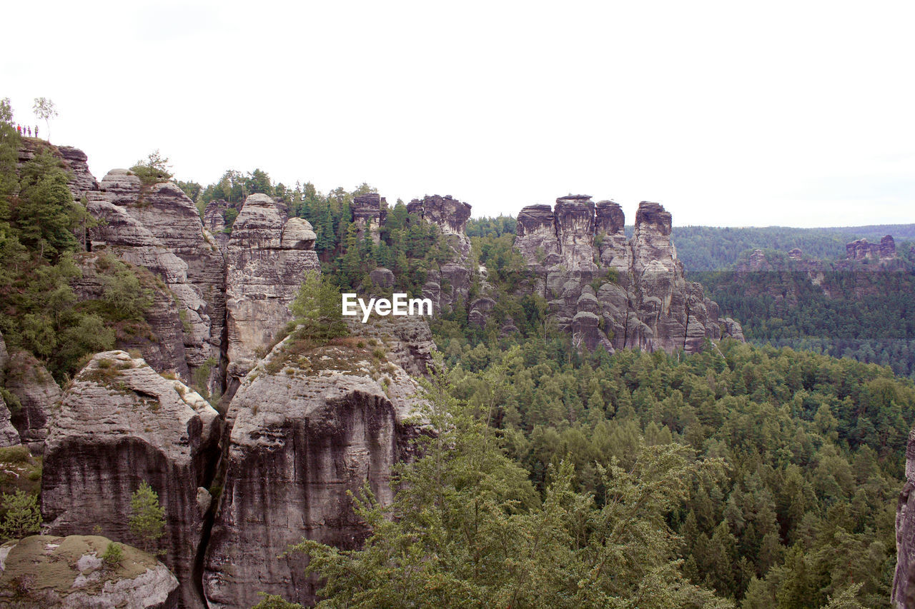 sky, rock, tree, nature, plant, rock - object, environment, rock formation, tranquil scene, tranquility, scenics - nature, beauty in nature, no people, clear sky, mountain, land, non-urban scene, solid, growth, landscape, outdoors, formation
