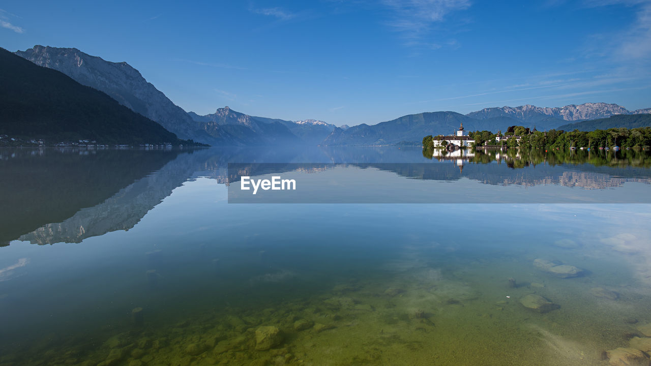 water, reflection, mountain, lake, beauty in nature, scenics - nature, tranquility, tranquil scene, sky, waterfront, nature, no people, day, idyllic, plant, non-urban scene, mountain range, standing water, cloud - sky, reflection lake