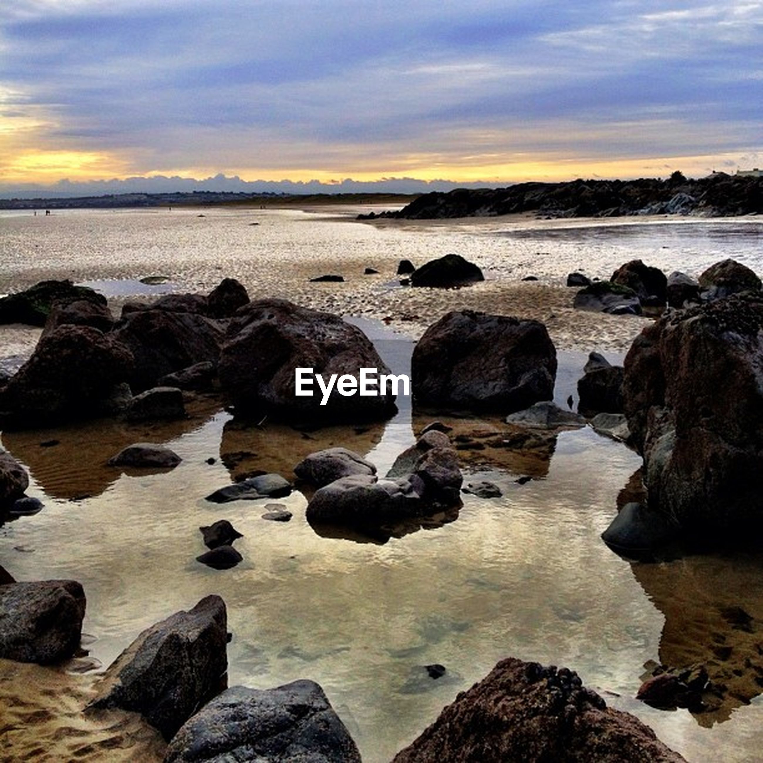 water, sea, rock - object, sky, scenics, beach, shore, beauty in nature, tranquil scene, sunset, tranquility, cloud - sky, horizon over water, nature, rock formation, rock, wave, idyllic, stone - object, cloud