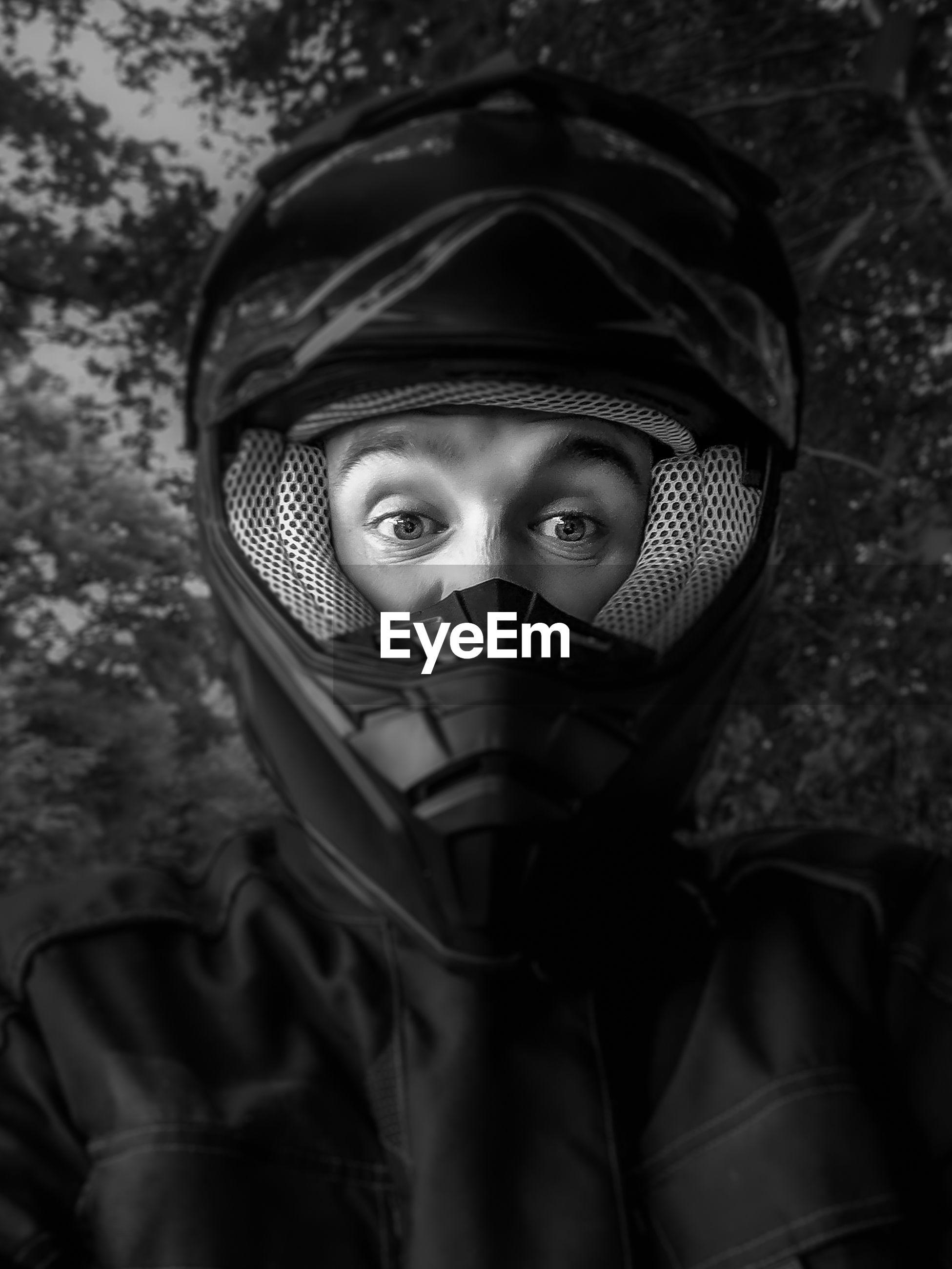 Close-up portrait of person wearing helmet