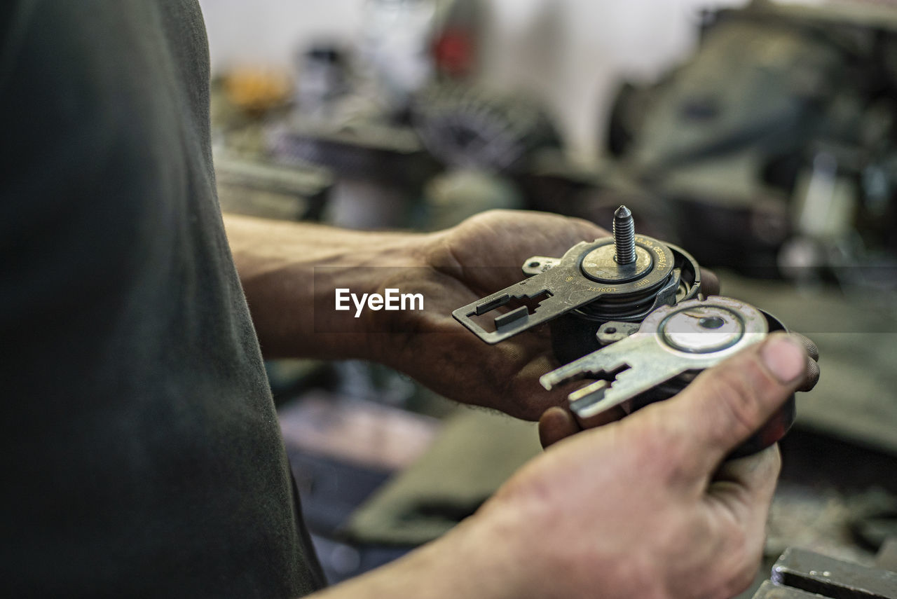Midsection of man working at machine