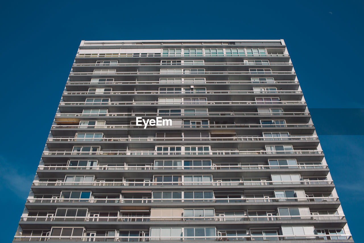 built structure, architecture, building exterior, building, low angle view, sky, window, city, blue, no people, modern, nature, clear sky, residential district, tall - high, outdoors, sunlight, apartment, day, in a row, skyscraper, place, luxury, location