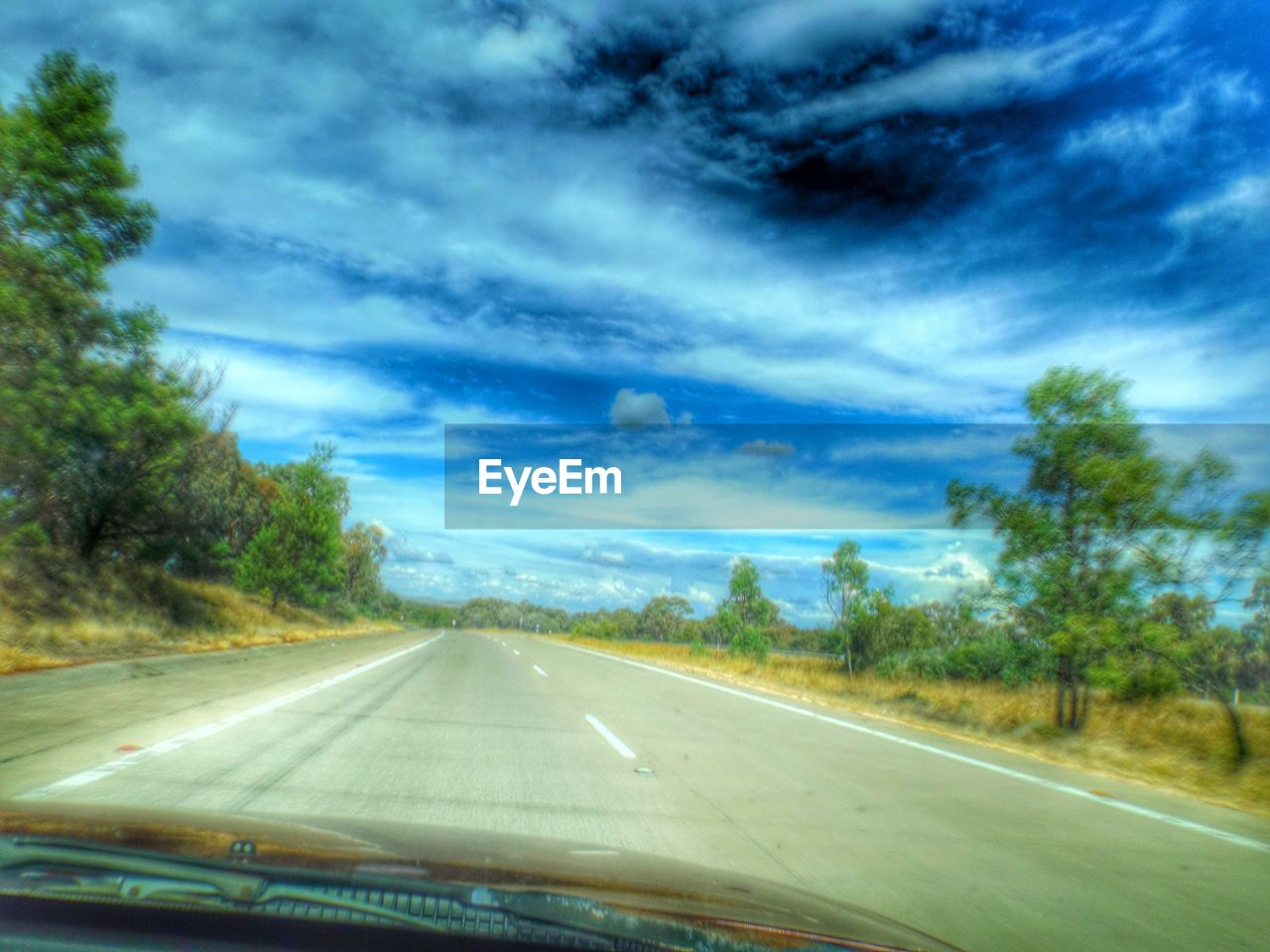 road, transportation, sky, cloud - sky, tree, the way forward, windshield, day, car interior, no people, landscape, nature, car point of view, scenics, land vehicle, car, outdoors, beauty in nature