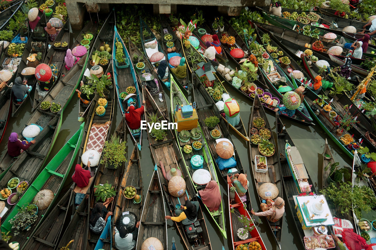 High angle view of people selling food on boats
