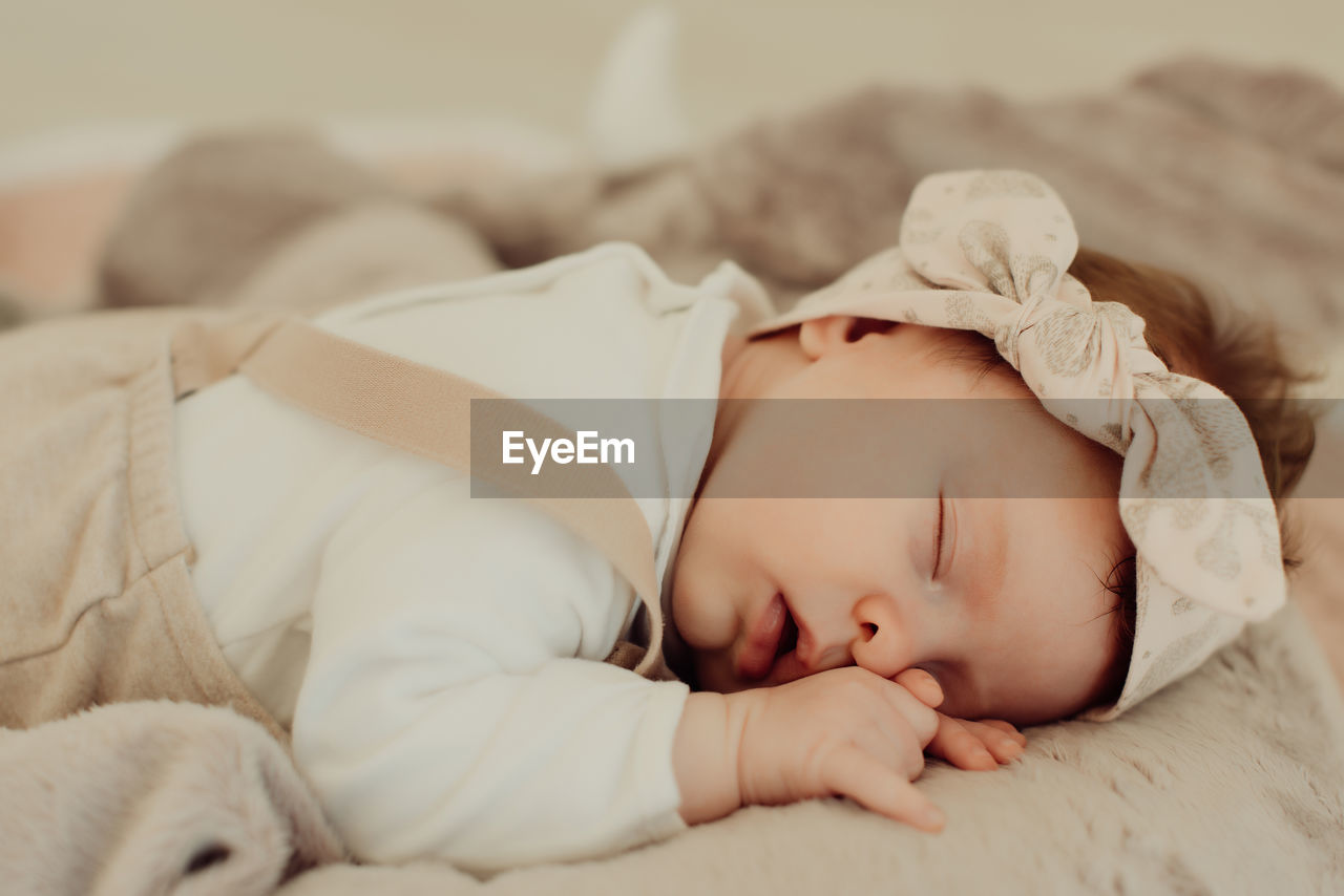 baby, childhood, furniture, child, bed, lying down, young, real people, innocence, babyhood, relaxation, one person, sleeping, resting, indoors, cute, eyes closed, toddler, newborn