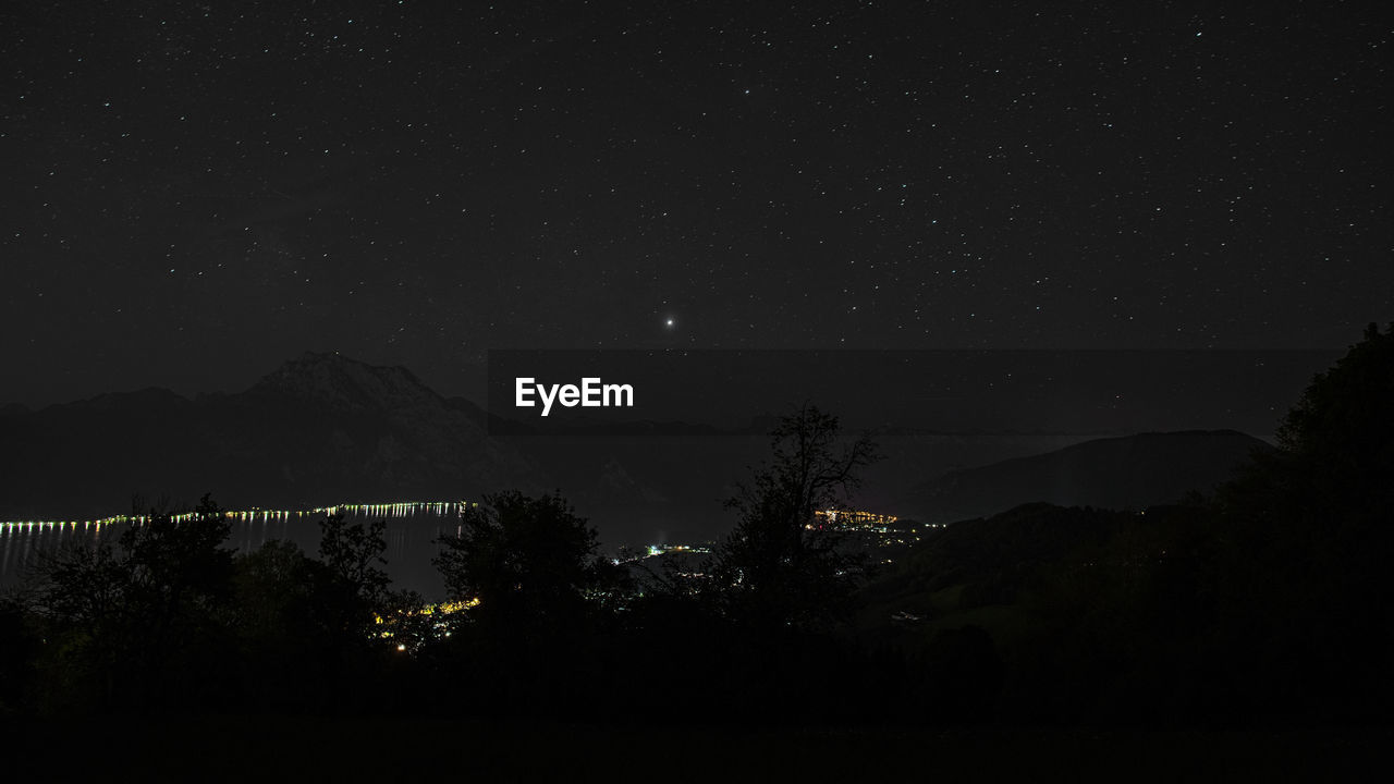 night, sky, mountain, scenics - nature, star - space, beauty in nature, space, no people, tranquility, silhouette, tree, tranquil scene, astronomy, nature, mountain range, plant, idyllic, star, galaxy, outdoors, moonlight