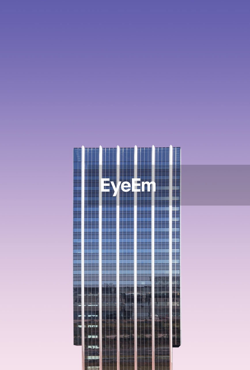 Digital composite image of modern building against colored background
