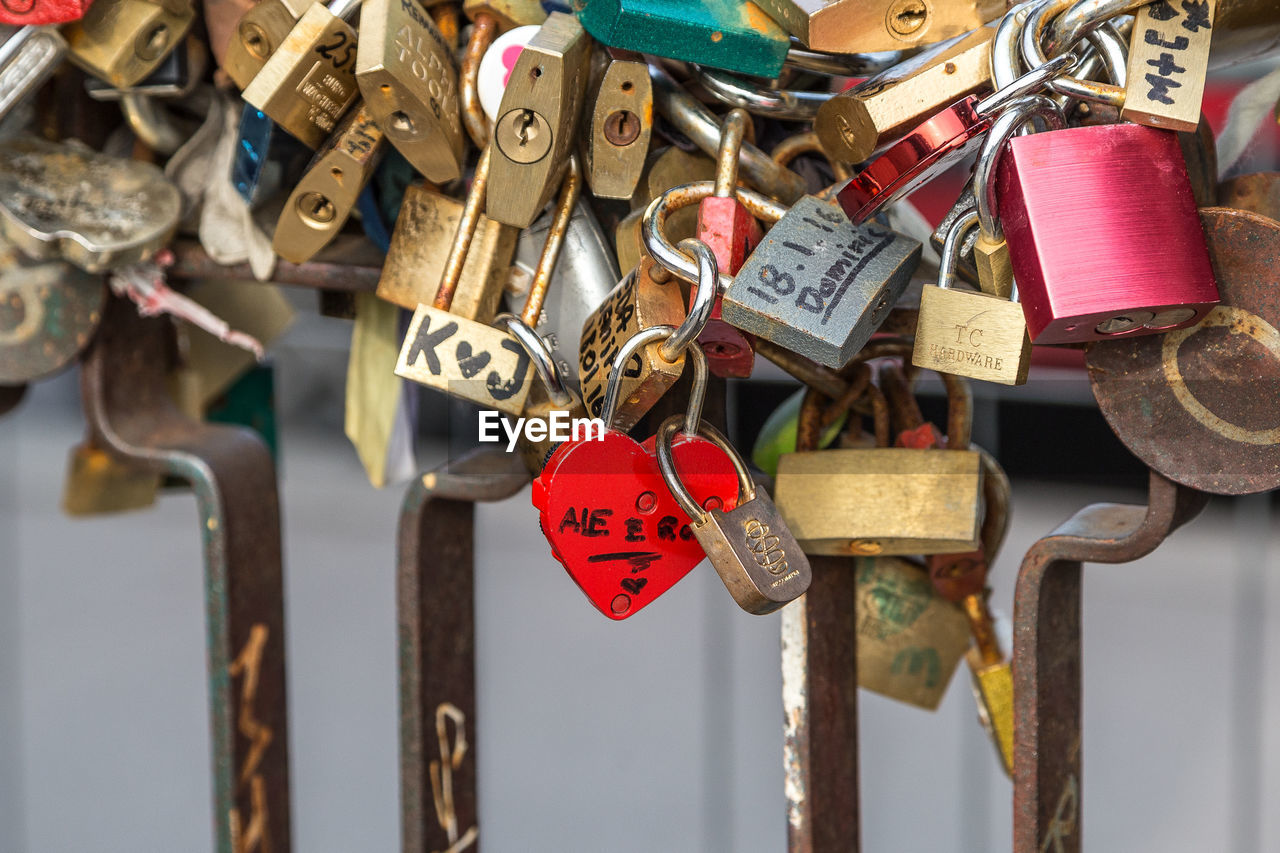 padlock, lock, love lock, love, security, safety, metal, hope, protection, hope - concept, hanging, heart shape, railing, abundance, luck, safe, no people, large group of objects, bridge - man made structure, outdoors, variation, day, romance, close-up, symbol, oath, bonding, key