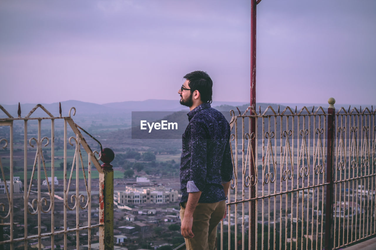 Man Standing At Observation Point Against Sky