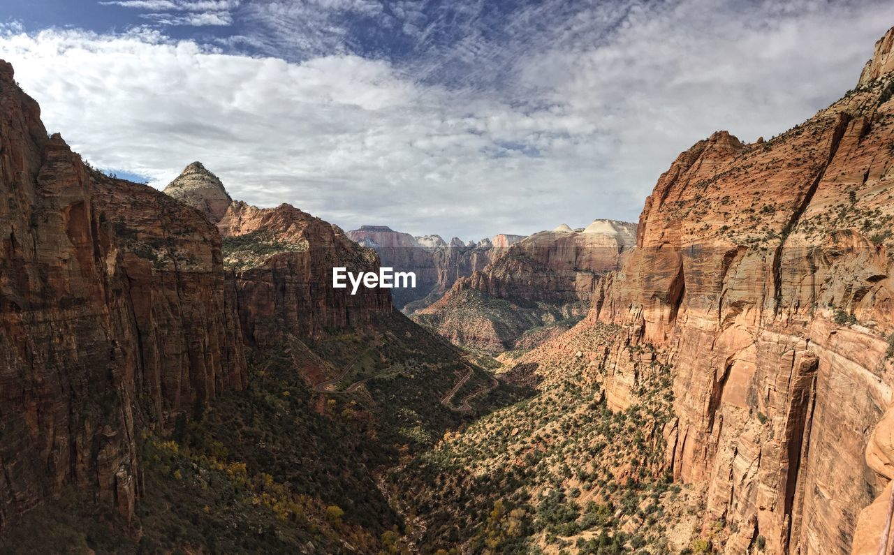 Scenic View Of Rocky Mountains At Zion National Park Against Sky