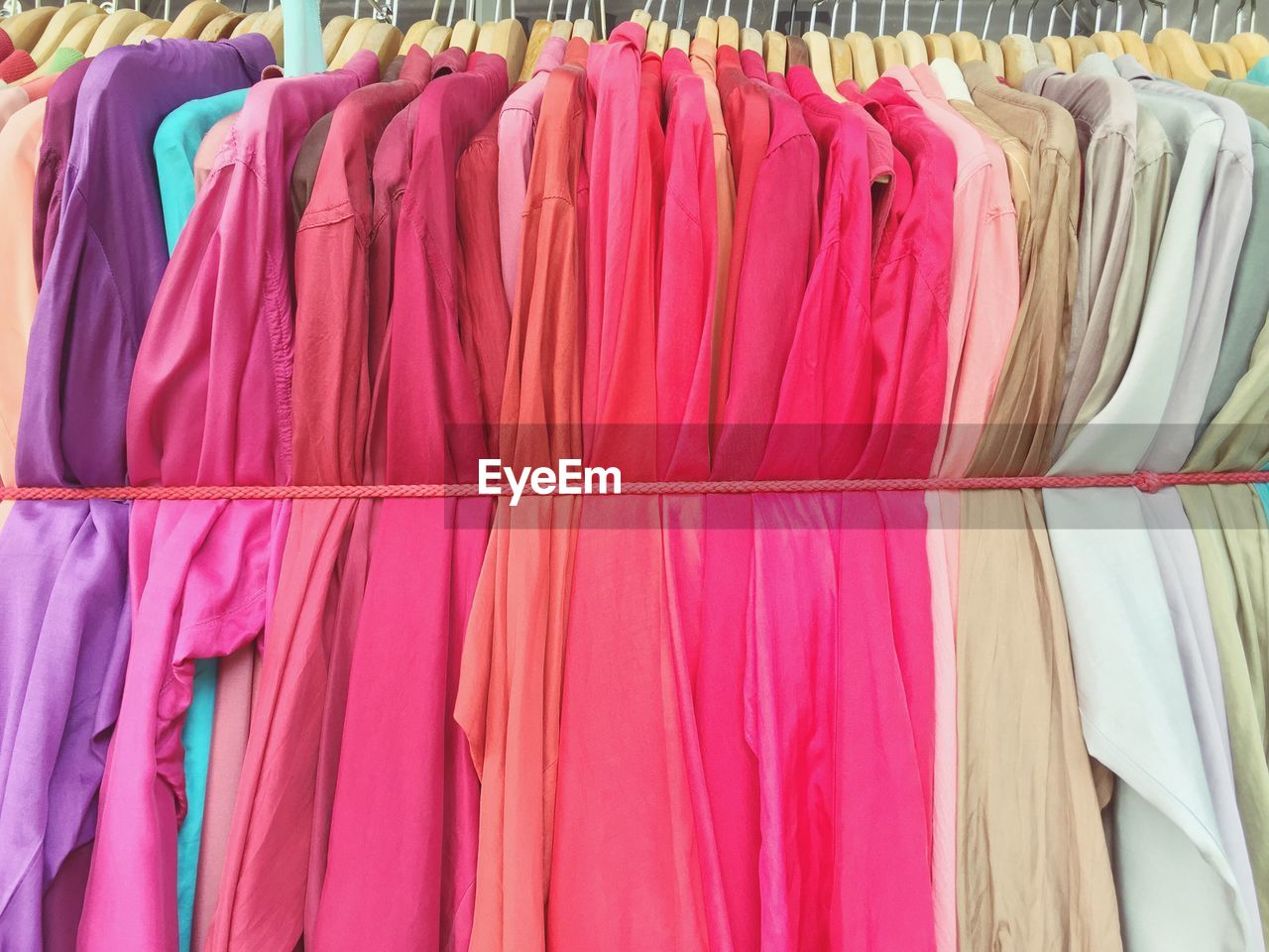 Close-Up Of Dress Handing For Sale In Store