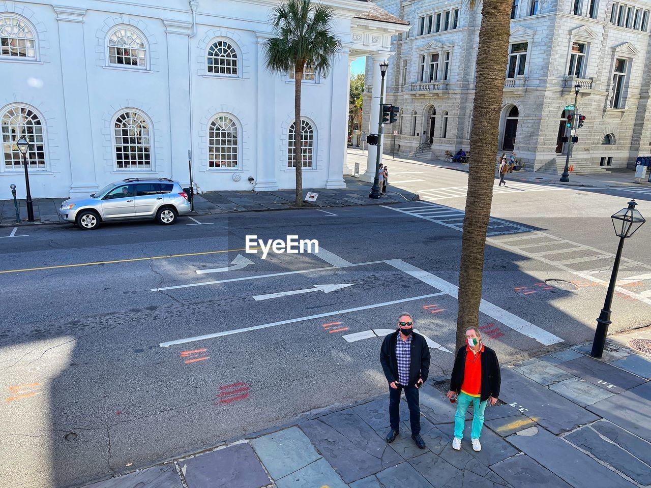 PEOPLE STANDING ON STREET