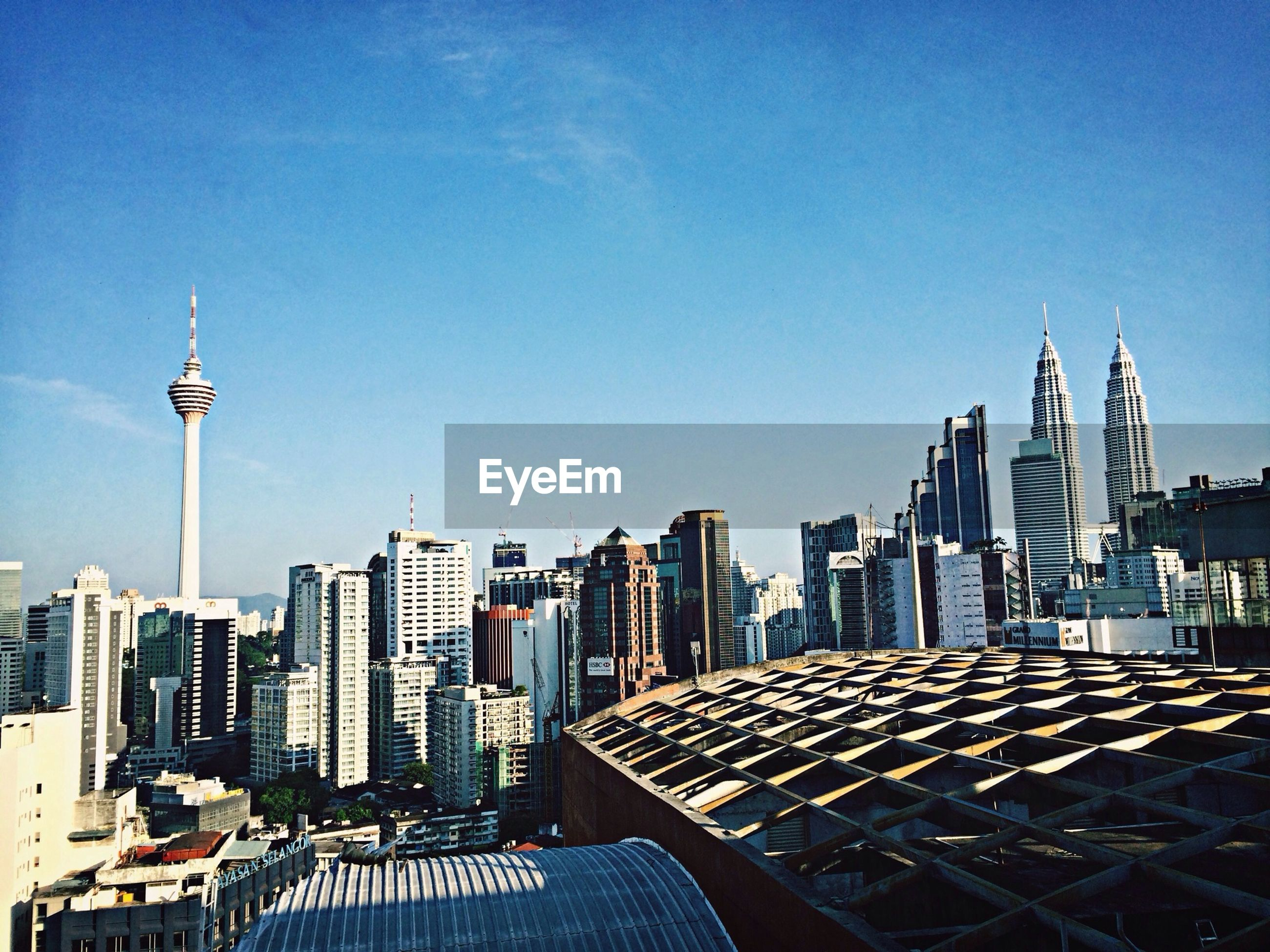 High angle view of cityscape and kuala lumpur tower against sky