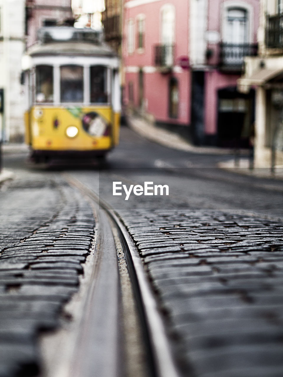 transportation, railroad track, mode of transport, rail transportation, public transportation, built structure, selective focus, land vehicle, day, architecture, yellow, outdoors, no people, building exterior, tilt-shift