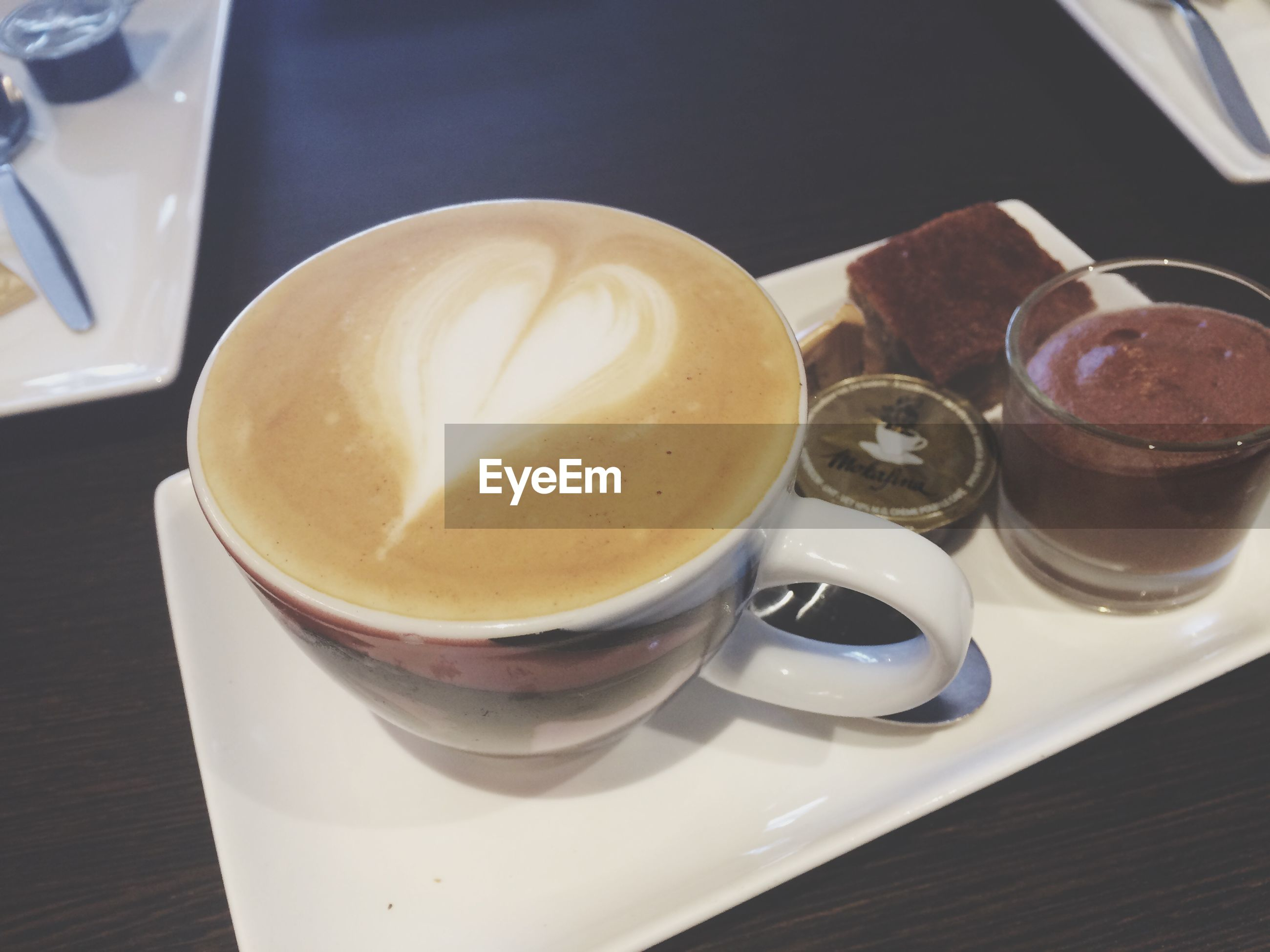 food and drink, drink, refreshment, indoors, table, coffee cup, freshness, coffee - drink, still life, frothy drink, saucer, close-up, cappuccino, coffee, high angle view, cup, no people, drinking glass, froth art, spoon