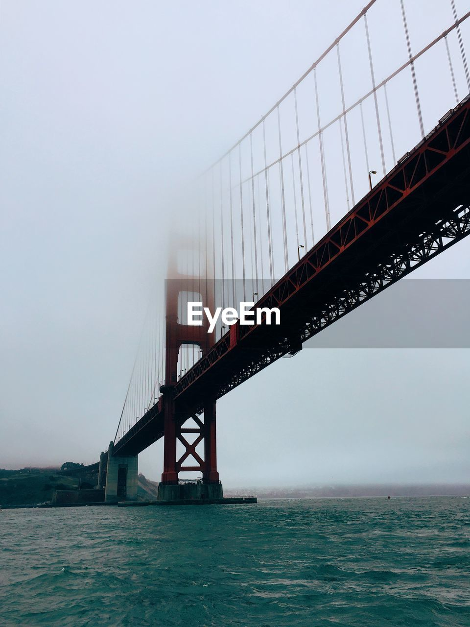 Golden gate bridge over san francisco bay in foggy weather against sky