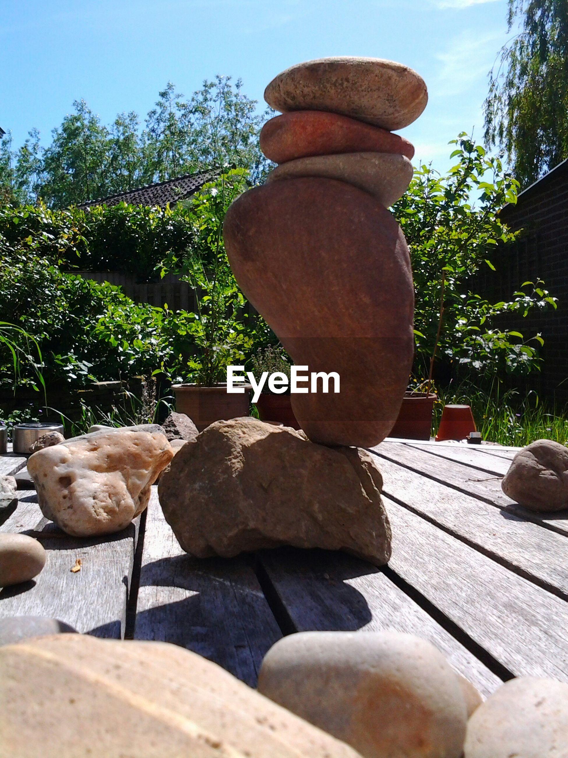 Stack of rocks on wooden boardwalk