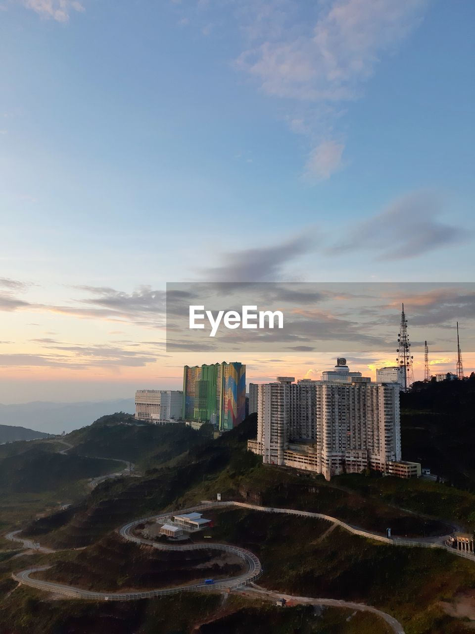 sky, building exterior, built structure, architecture, cloud - sky, city, building, sunset, cityscape, office building exterior, nature, no people, skyscraper, tall - high, landscape, outdoors, transportation, road, tower, high angle view, modern