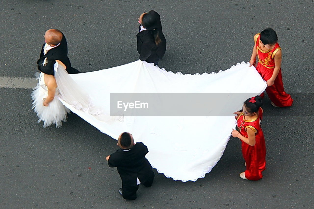 group of people, white color, men, high angle view, day, full length, real people, women, adult, bride, rear view, clothing, people, wedding, celebration, newlywed, wedding dress, bridegroom, event, outdoors