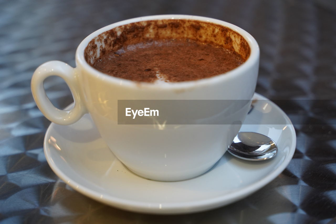 food and drink, coffee, drink, refreshment, coffee cup, mug, coffee - drink, cup, saucer, crockery, still life, indoors, frothy drink, table, close-up, no people, freshness, brown, focus on foreground, white color, hot drink, non-alcoholic beverage, temptation