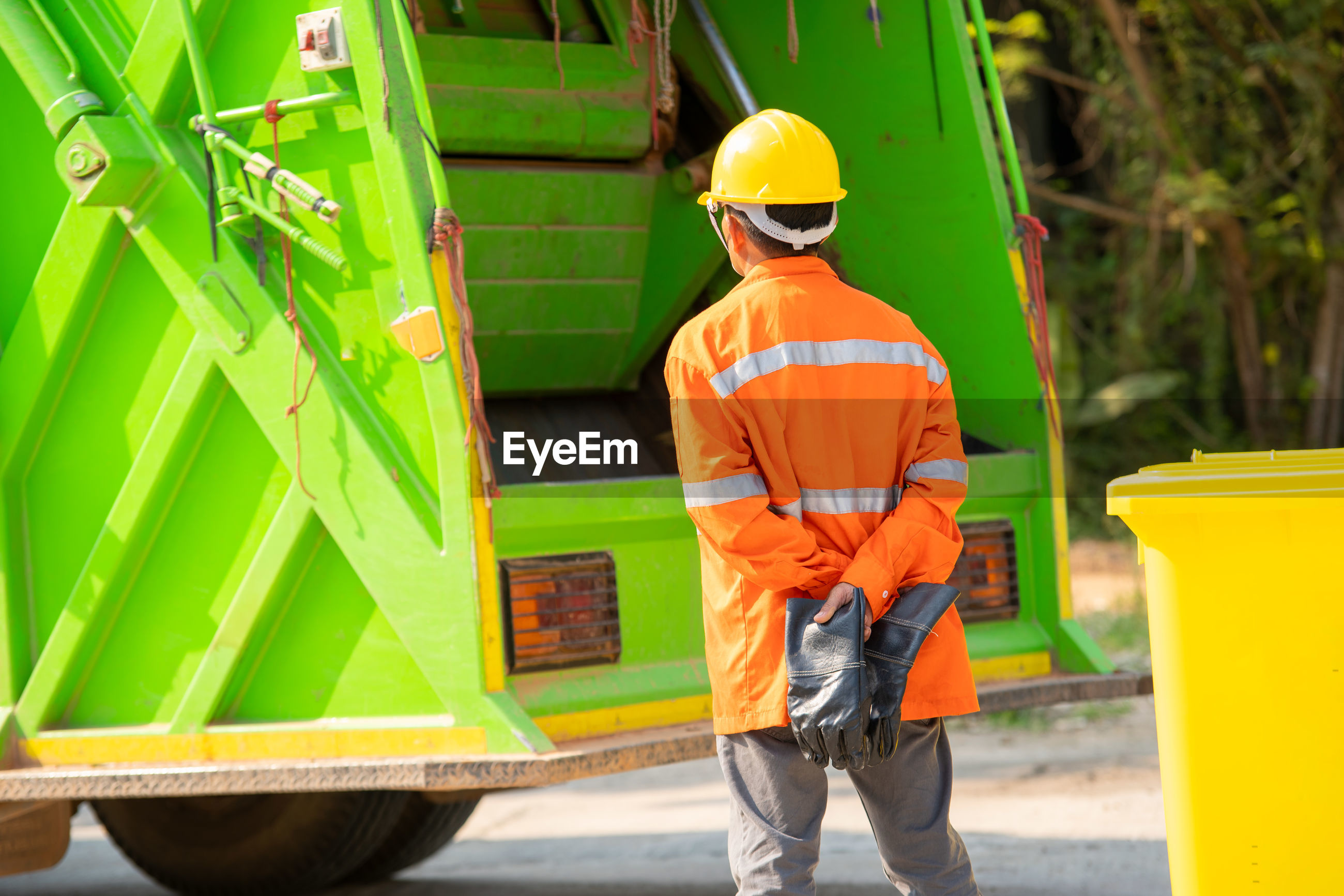 FULL LENGTH OF MAN WORKING IN YELLOW