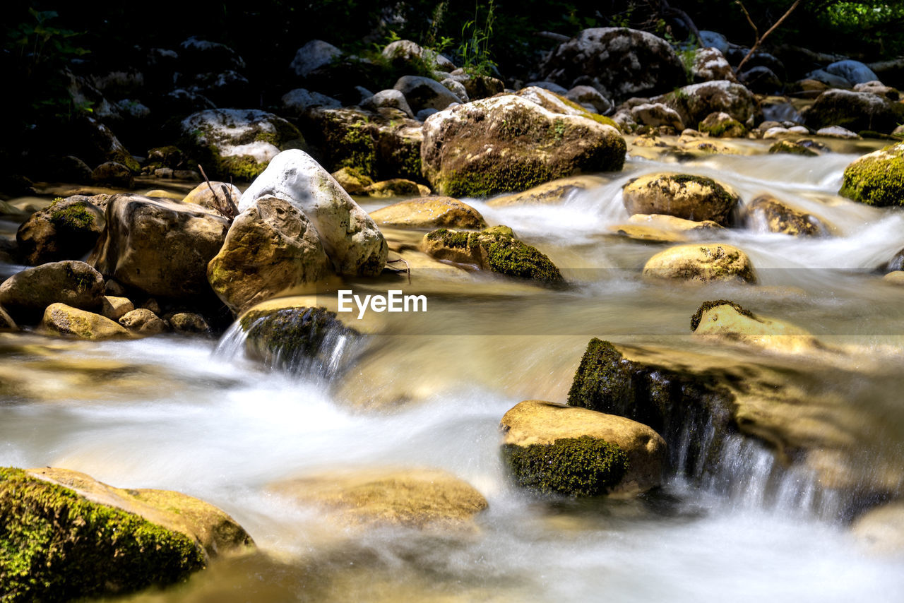 water, rock, long exposure, rock - object, motion, scenics - nature, beauty in nature, blurred motion, solid, flowing water, waterfall, nature, flowing, no people, land, forest, day, river, stream - flowing water, outdoors, power in nature, falling water, running water