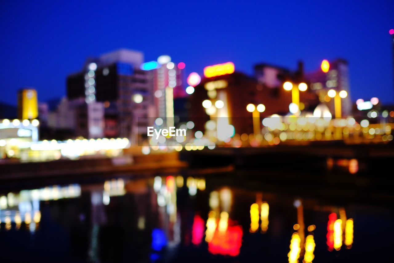 illuminated, night, architecture, reflection, glowing, built structure, building exterior, no people, water, outdoors, defocused, city, sky
