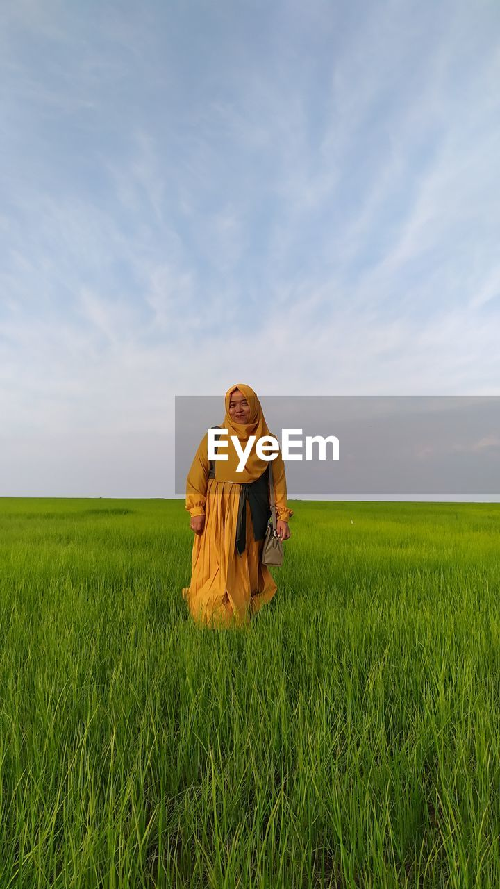 View of person in field against sky