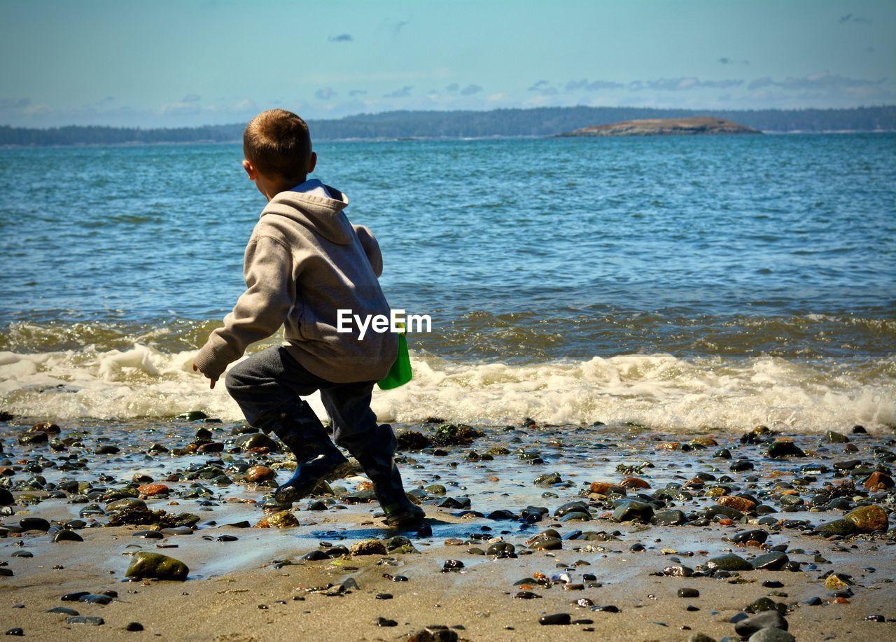 Boy jumping at beach