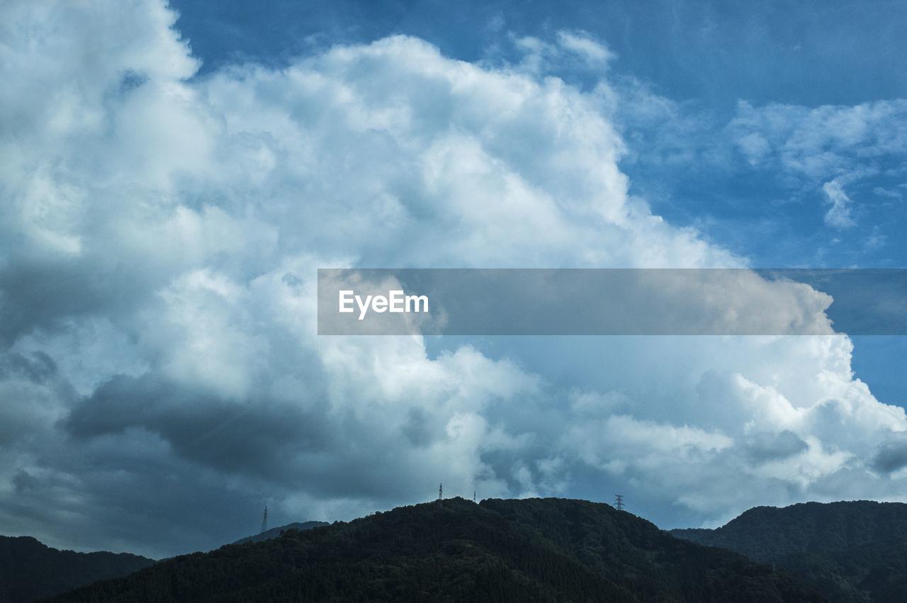cloud - sky, sky, beauty in nature, mountain, scenics - nature, tranquil scene, tranquility, nature, no people, non-urban scene, day, outdoors, environment, low angle view, idyllic, overcast, landscape, mountain range, land, mountain peak