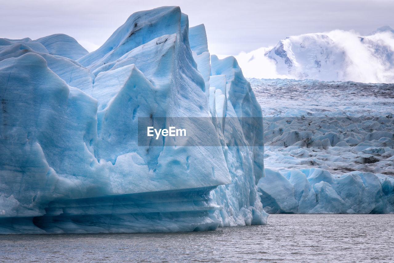 View of glacier in sea against sky