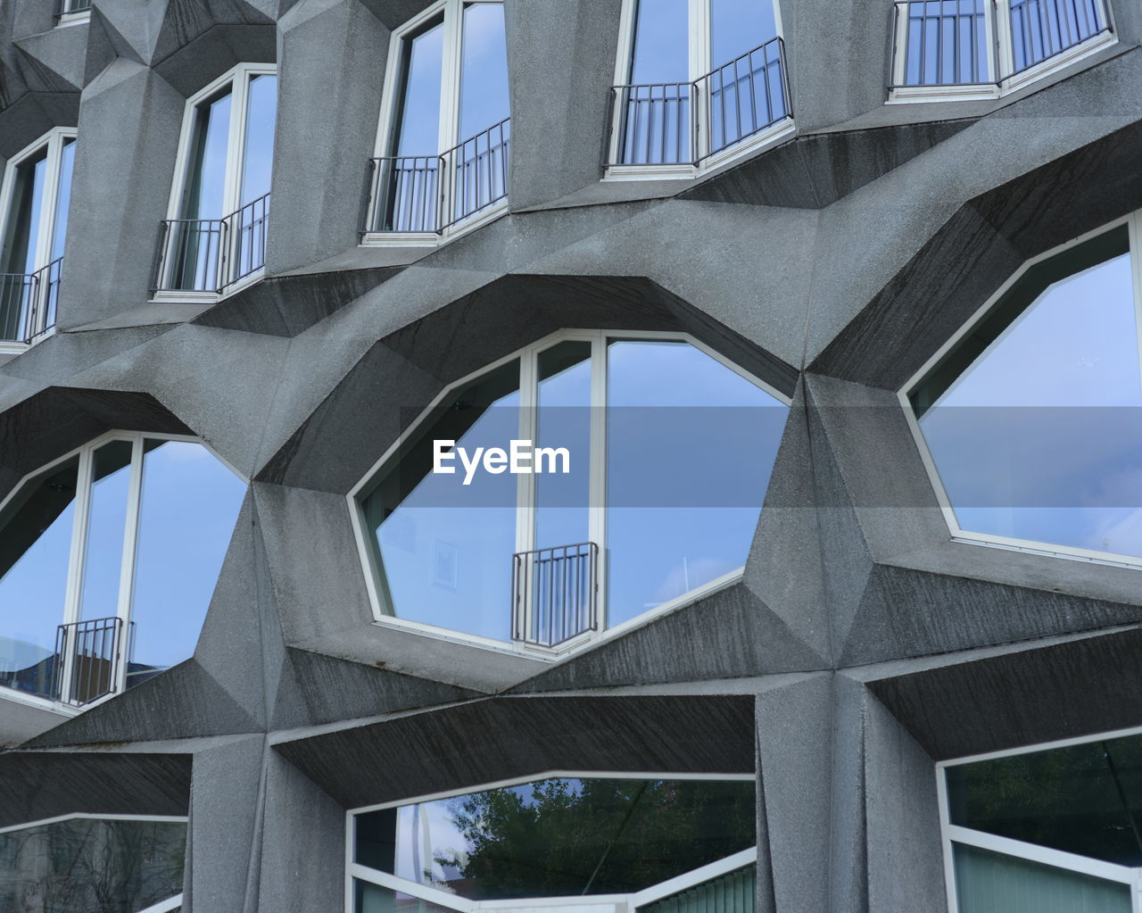 architecture, built structure, building exterior, day, low angle view, outdoors, bridge - man made structure, no people, city, sky