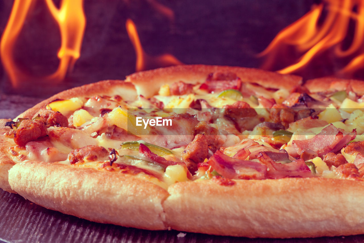 CLOSE-UP OF PIZZA SLICE ON BARBECUE
