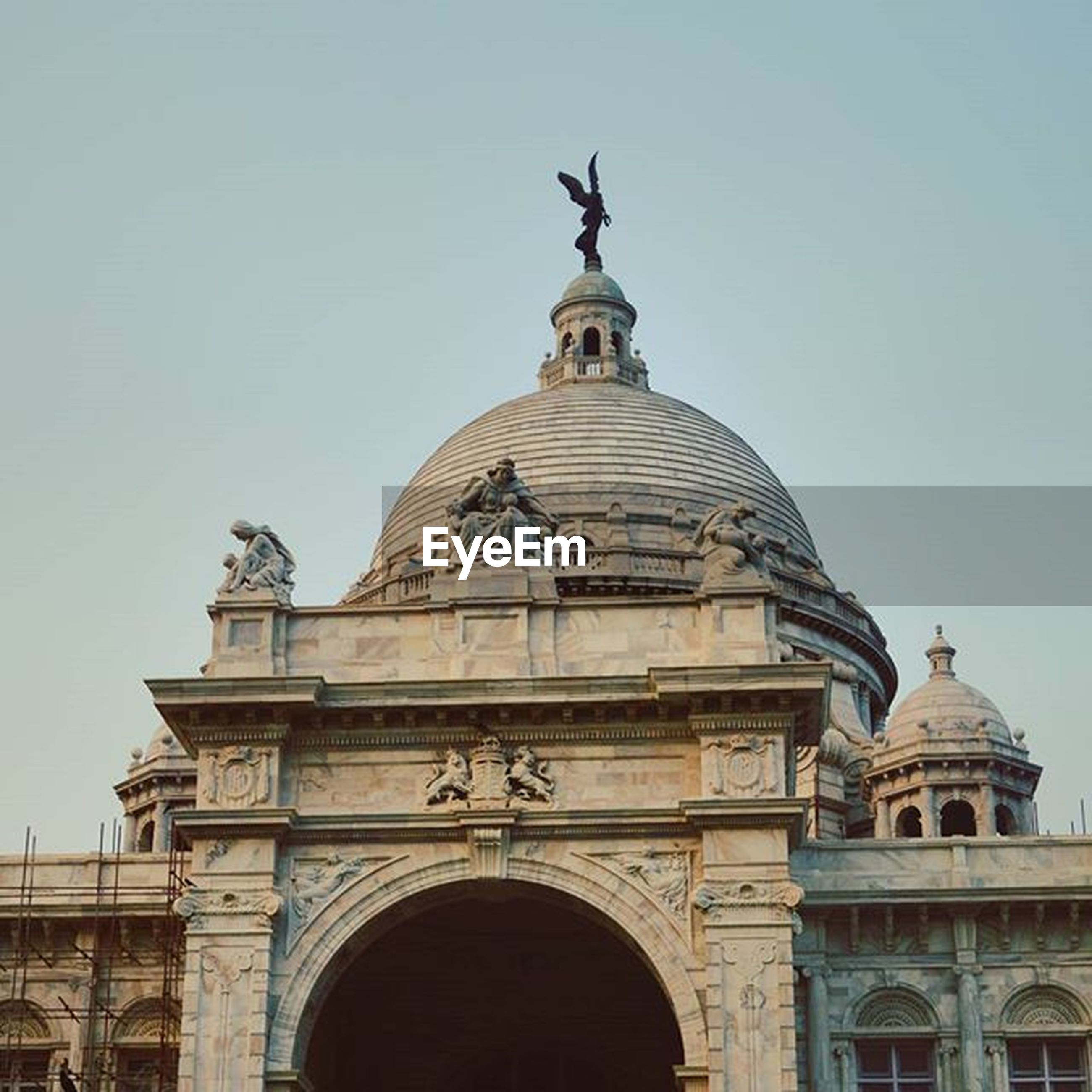 statue, architecture, art and craft, sculpture, human representation, built structure, art, low angle view, dome, clear sky, building exterior, creativity, famous place, religion, travel destinations, place of worship, spirituality, travel, tourism
