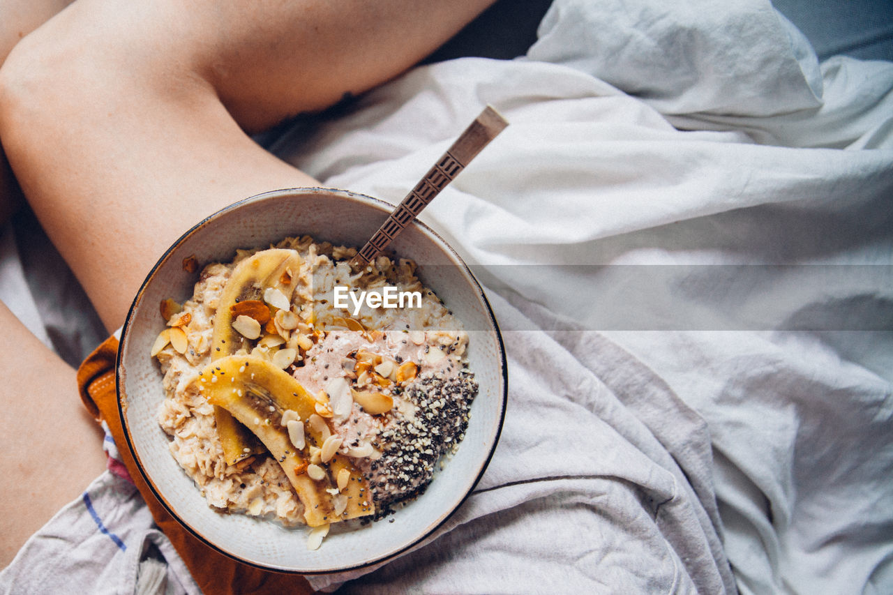 Close-Up Of Woman Having Breakfast In Bed