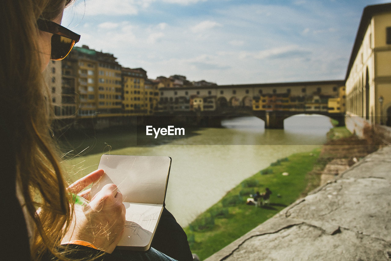 Woman Making Sketch Of Ponte Vecchio Over Arno River