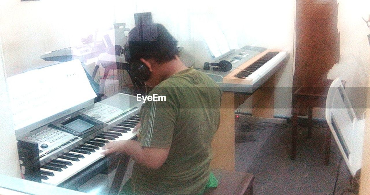 music, piano, musical instrument, playing, pianist, musician, piano key, arts culture and entertainment, men, indoors, skill, one person, lifestyles, technology, real people, learning, performance, sitting, one man only, day, adult, young adult, people, adults only