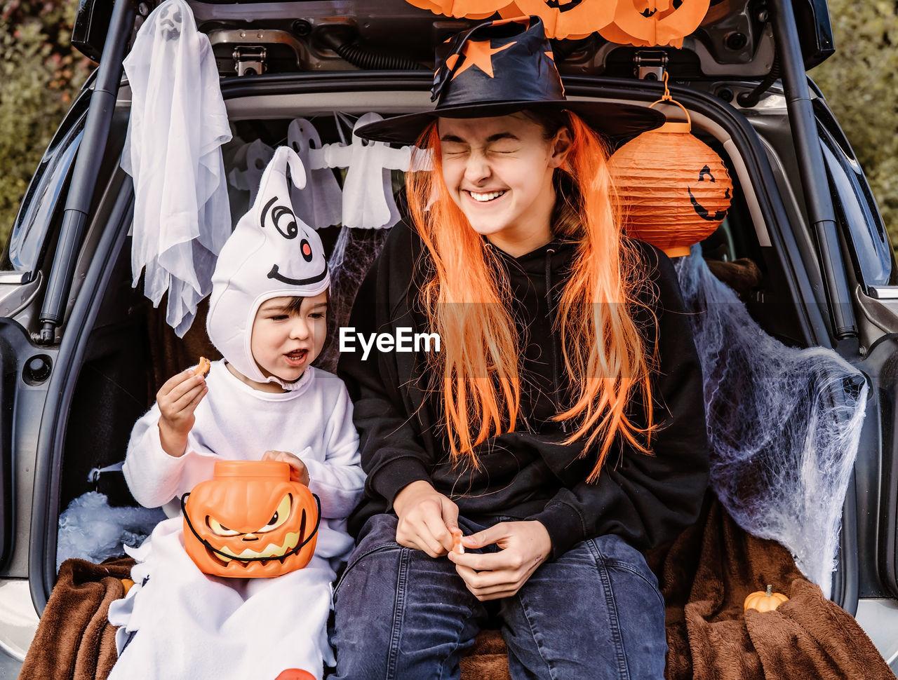 Portrait of cute boy with jack o lantern during halloween