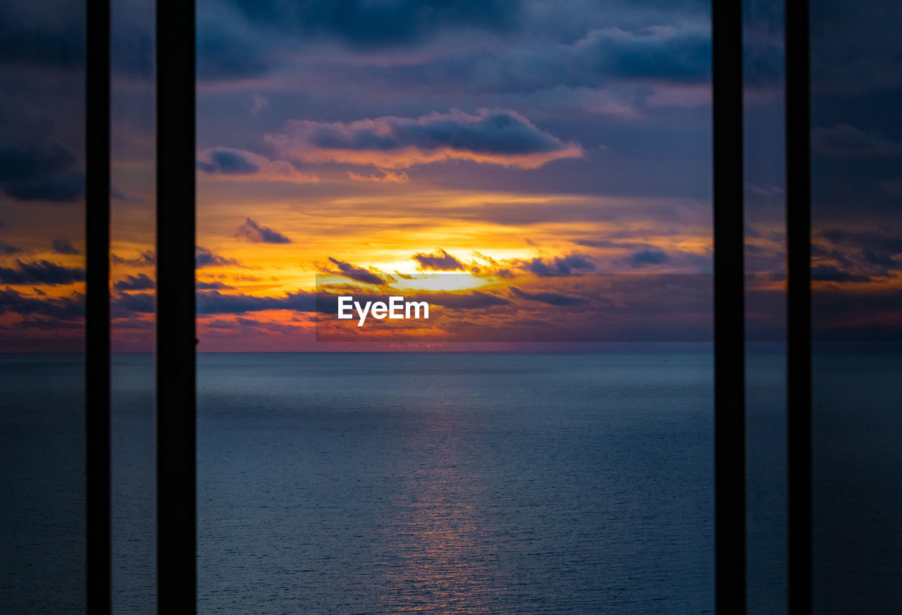 sky, orange color, scenics - nature, cloud - sky, beauty in nature, sea, water, sunset, horizon over water, horizon, tranquility, no people, tranquil scene, nature, idyllic, window, outdoors, transparent, glass - material