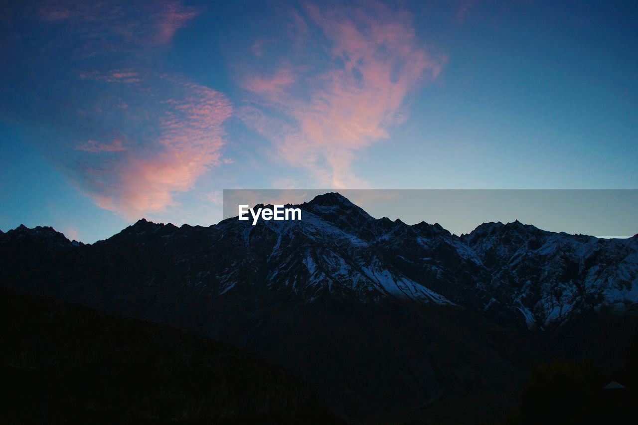 mountain, sky, beauty in nature, scenics - nature, tranquil scene, tranquility, mountain range, cloud - sky, non-urban scene, environment, no people, landscape, idyllic, nature, mountain peak, sunset, cold temperature, silhouette, physical geography, majestic, outdoors, snowcapped mountain