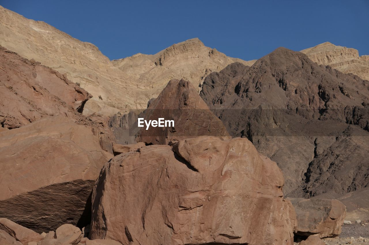 geology, mountain, arid climate, physical geography, nature, rock - object, landscape, tranquil scene, sunlight, beauty in nature, day, scenics, desert, outdoors, no people, mountain range, clear sky, sky
